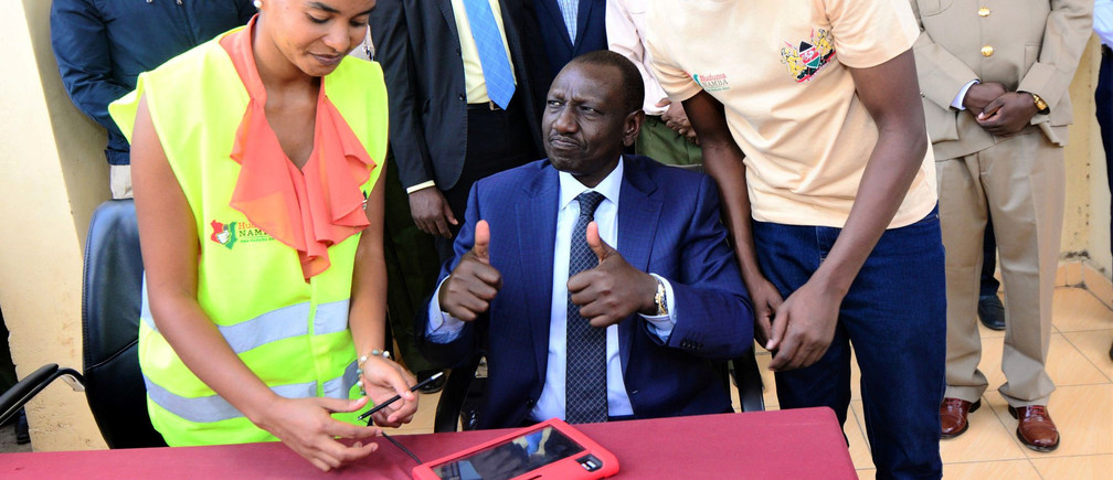 Kenya's Deputy President William Ruto prepares his thumbs during his registration to the digital identification system locally known as Huduma Number in Nairobi, Kenya April 9, 2019. Picture taken April 9, 2019. REUTERS/Njeri Mwangi - RC23RE9X11WP