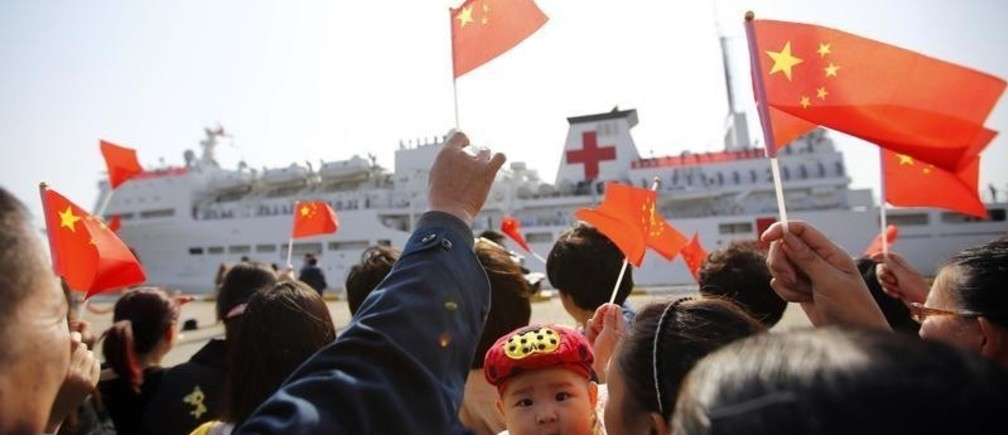 """Relatives of crew members wave Chinese flags as China's hospital ship """"Peace Ark"""" leaves a naval port for the Philippines, to assist the victims of Typhoon Haiyan, in Zhoushan Island, Zhejiang Province November 21, 2013. China is sending a hospital ship to the Philippines following foreign and domestic criticism that it was slow and less than generous in its response to one of the world's biggest typhoons, which killed at least 4,000 people. The Foreign Ministry in Beijing confirmed on Tuesday the deployment of the 14,000-tonne """"Peace Ark"""" as state television reported the arrival of the first batch of Chinese relief supplies in the Philippines.  REUTERS/Carlos Barria  (CHINA - Tags: POLITICS MILITARY SOCIETY HEALTH MARITIME TPX IMAGES OF THE DAY) - GM1E9BL0Z9301"""