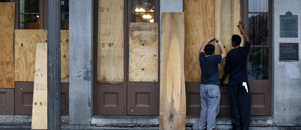 Business owners board up their restaurant in the French Quarter as Hurricane Nate approaches the U.S. Gulf Coast in New Orleans, Louisiana, U.S.  October 7, 2017. REUTERS/Jonathan Bachman - RC1765E2CC60