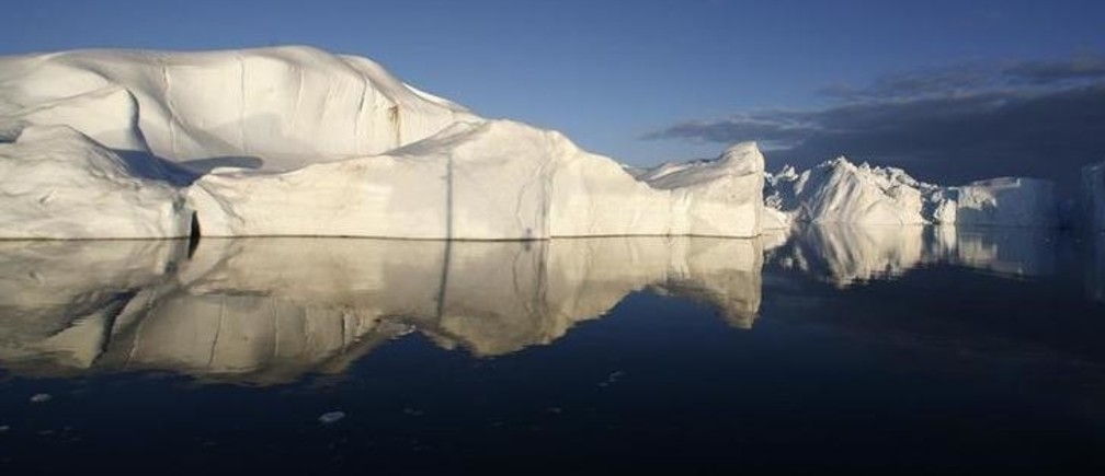 Icebergs are reflected in the calm waters at the mouth of the Jakobshavn ice fjord near Ilulissat in Greenland in this photo taken May 15, 2007. New York, Boston and other cities on North America's northeast coast could face a rise in sea level this century that would exceed forecasts for the rest of the planet if Greenland's ice sheet keeps melting as fast as it is now, researchers said May 27, 2009. Sea levels off the northeast coast of North America could rise by 12 to 20 inches more than other coastal areas if the Greenland glacier-melt continues to accelerate at its present pace, the researchers reported.