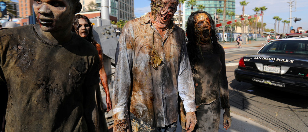 A group of zombies arrive in costume as they participate in the opening preview night at Comic Con International in San Diego,California, U.S., July 19, 2017.     REUTERS/Mike Blake - RC1D3723C990