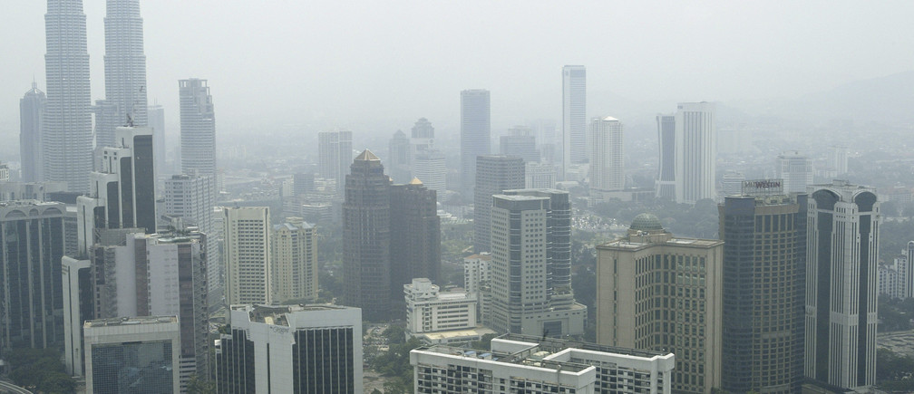 Kuala Lumpur's skyline is slightly obscured by haze on August 12, 2003. Smoke from a few local fires, combined in recent days with hot and dry weather, caused haze in major districts, mostly on peninsular Malaysia's west coast.