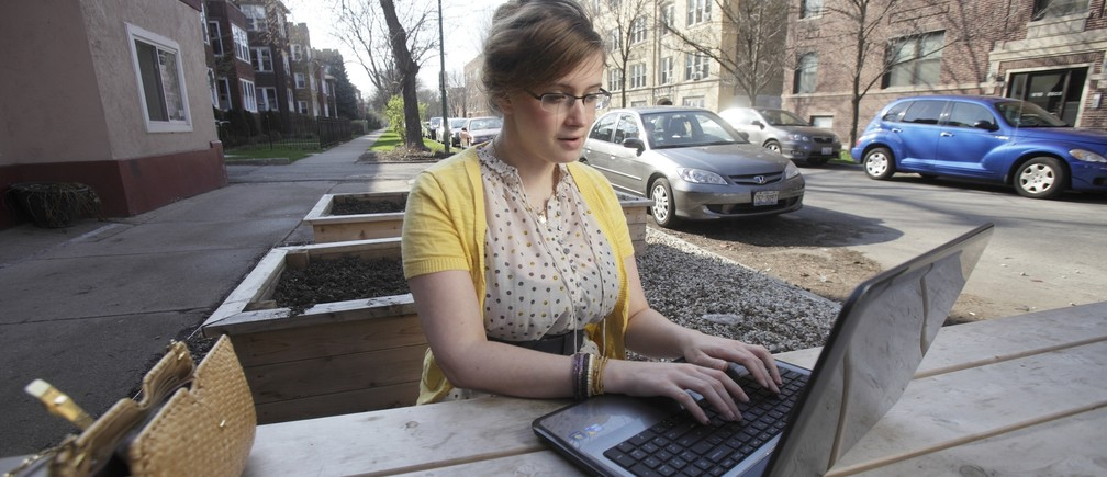 Fruzsina Eordogh works outside a cafe in Chicago, March 19, 2012.