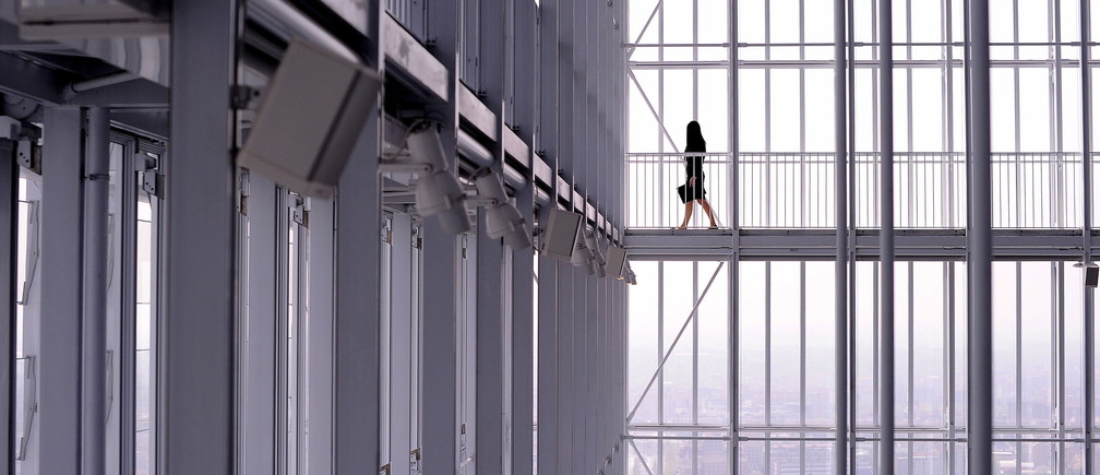 A woman walks inside the new Intesa Sanpaolo skyscraper, designed by Italian architect Renzo Piano, in Turin April 10, 2015.