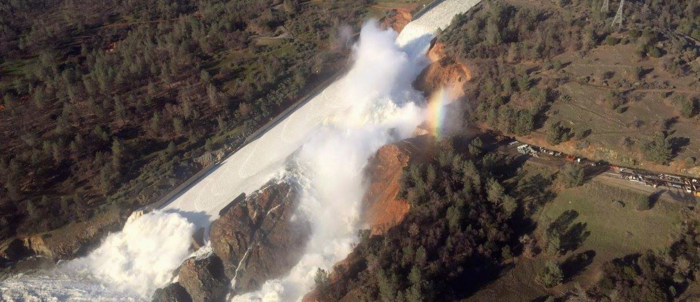 A damaged spillway with eroded hillside is seen in an aerial photo taken over the Oroville Dam in Oroville, California, U.S. February 11, 2017.  California Department of Water Resources/William Croyle/Handout via REUTERS  ATTENTION EDITORS - THIS IMAGE WAS PROVIDED BY A THIRD PARTY. EDITORIAL USE ONLY. THIS PICTURE WAS PROCESSED BY REUTERS TO ENHANCE QUALITY. AN UNPROCESSED VERSION HAS BEEN PROVIDED SEPARATELY.    TPX IMAGES OF THE DAY - RTSYD5R