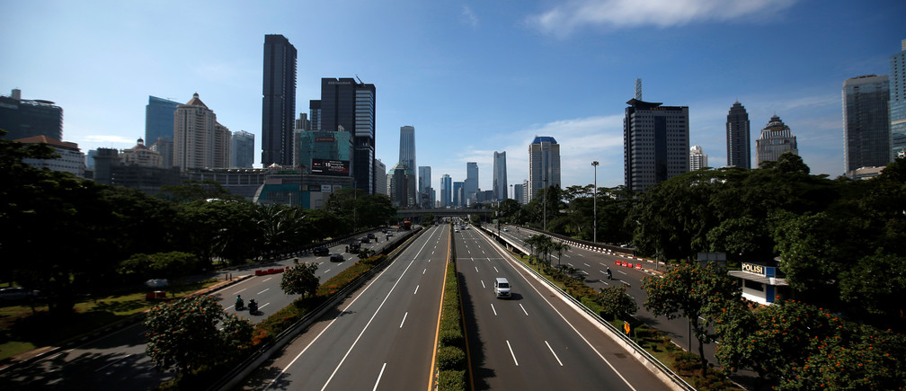A view of almost empty main road amid the spread of coronavirus disease (COVID-19) in Jakarta, Indonesia, March 31, 2020. REUTERS/Willy Kurniawan - RC2YUF9M1T5U