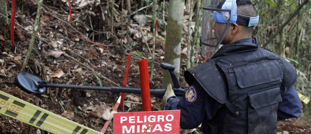A member of the Humanitarian Demining Battalion of the Columbian Army searches for landmines in Cocorna, Antioquia March 3, 2015. According to the United Nations Mines Action Service, Colombia has the second highest number of victims from landmines in the world, after Afghanistan. REUTERS/Fredy Builes