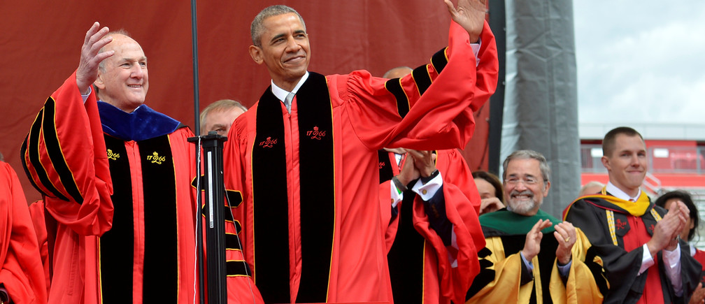 U.S. President Barack Obama acknowledges the applause as he is escorted by Rutgers President Robert Barchi at High Point Solutions Stadium during Rutgers University's 250th commencement exercises, in New Brunswick, New Jersey, May 15, 2016.