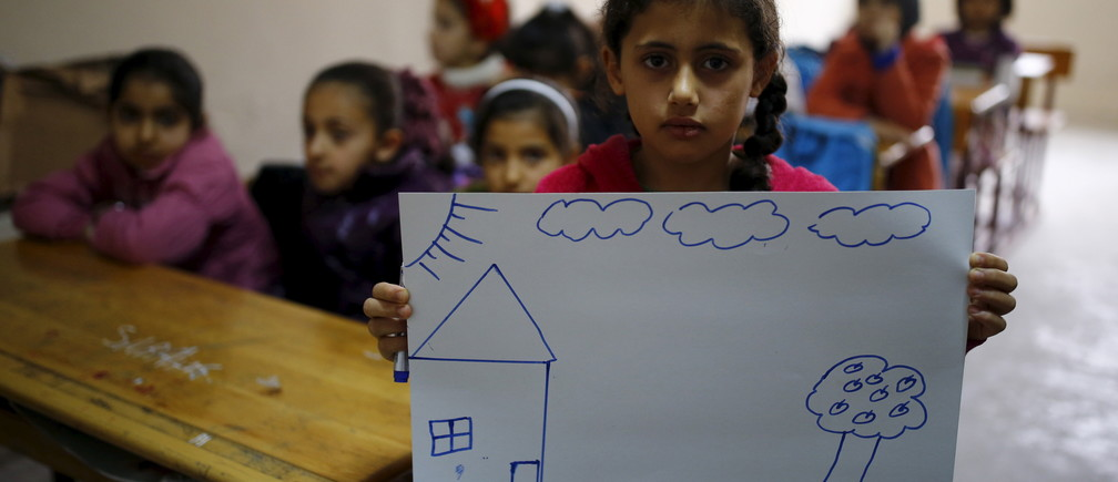 Syrian refugee girl Nur El-Huda, 9, shows a drawing of her home in Syria, in her classroom in Yayladagi refugee camp in Hatay province near the Turkish-Syrian border, Turkey, December 16, 2015. Syria's conflict has left hundreds of thousands dead, pushed millions more into exile, and had a profound effect on children who lost their homes or got caught up in the bloodletting. The drawings of young refugees living in Turkey show their memories of home and hopes for its future. The pictures also point to the mental scars borne by 2.3 million Syrian refugees living in Turkey, more than half of them children. REUTERS/Umit Bektas