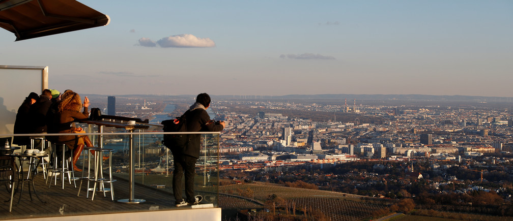 Tourists enjoy a sunny day on mount Kahlenberg in Vienna, Austria March 12, 2019. Picture taken March 12, 2019.   REUTERS/Leonhard Foeger - RC130100FEB0