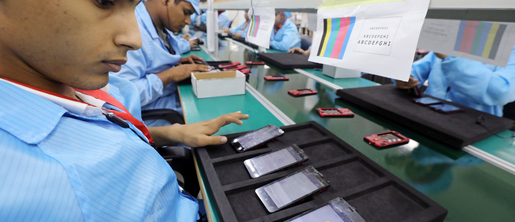 Egyptians working at a mobile-phone factory.