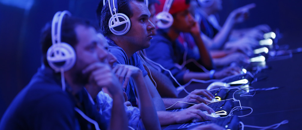 "Gamers play the ""StarCraft II"" developed by video game producer Blizzard Entertainment during the Gamescom 2015 fair in Cologne, Germany August 5, 2015."
