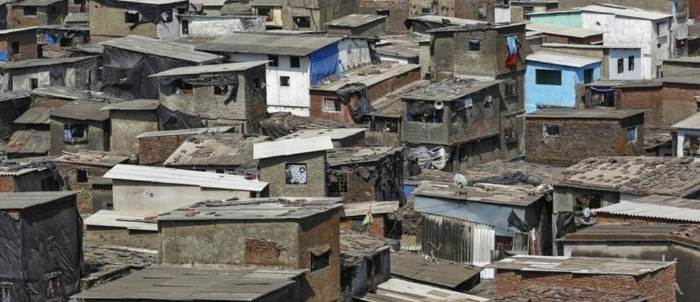 A cluster of houses is seen at a slum in Mumbai May 6, 2014. India needs about 19 million low-cost homes - roughly defined as costing a million rupees ($16,700) and below - to shelter an urban population expected to nearly double to 600 million by 2030 from 2011. The Bharatiya Janata Party (BJP), led by prime ministerial front-runner Modi, promised in its election manifesto to adopt a a low-cost housing policy that would ensure every family in Asia's third-largest economy has a home by 2022. Picture taken May 6, 2014.      REUTERS/Danish Siddiqui (INDIA - Tags: POLITICS ELECTIONS BUSINESS REAL ESTATE) - GM1EA5E0Z6A01