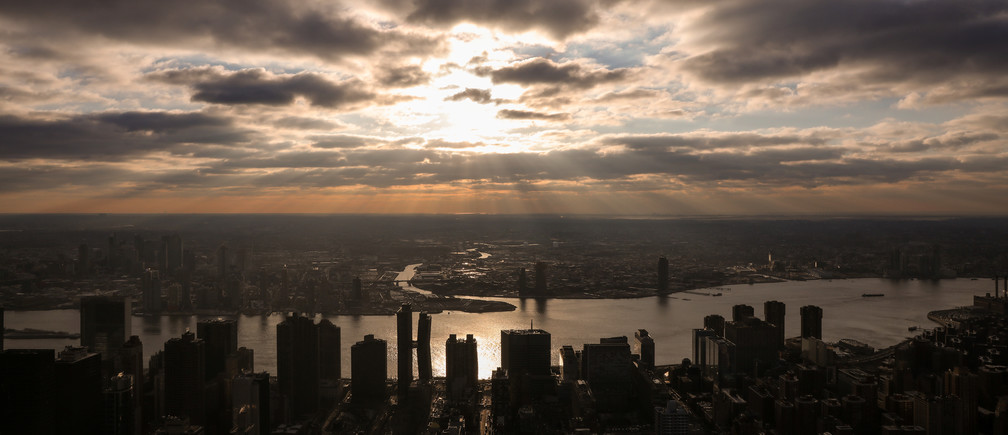 The sun peaks through the clouds above the East River as seen from the Empire State Building in New York City, U.S., February 14, 2019