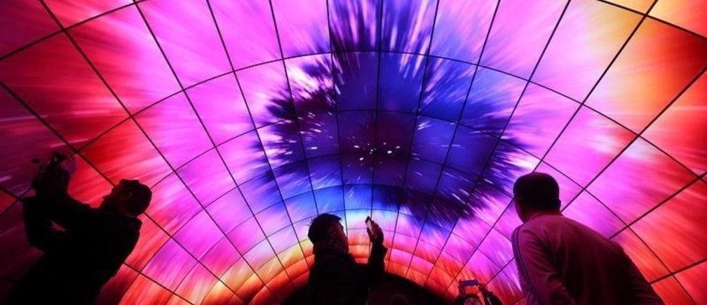 Attendees view video on a tunnel of LG OLED televisions during the 2017 CES in Las Vegas, Nevada, U.S., January 5, 2017. REUTERS/Steve Marcus