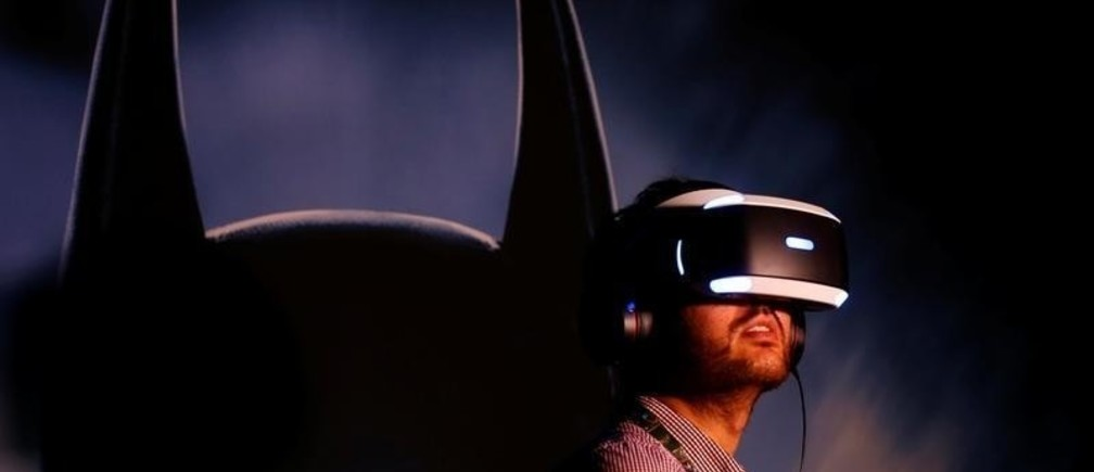People try the new Sony VR headset during Sony Corporation's PlayStation 4 E3 2016 event.
