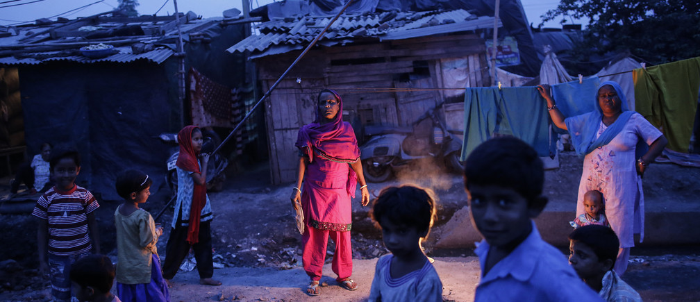 Fifty-five-year-old Subna Bi (C), poses for a picture outside her house next to the abandoned former Union Carbide Corp pesticide plant in Bhopal November 15, 2014.