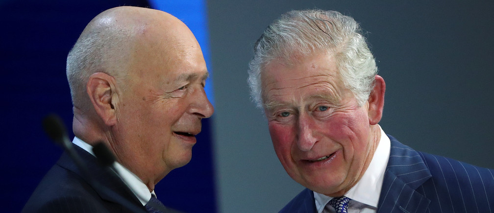 HRH The Prince of Wales speaks with Klaus Schwab, Founder and Executive Chairman of World Economic Forum, before his special address at the 50th World Economic Forum (WEF) annual meeting in Davos, Switzerland, January 22, 2020. REUTERS/Denis Balibouse - RC22LE9EBNPL
