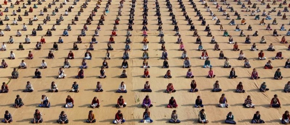 Schoolchildren attend a yoga session at a camp in Ahmedabad, India January 5, 2017. REUTERS/Amit Dave     TPX IMAGES OF THE DAY - RC18C3563B90