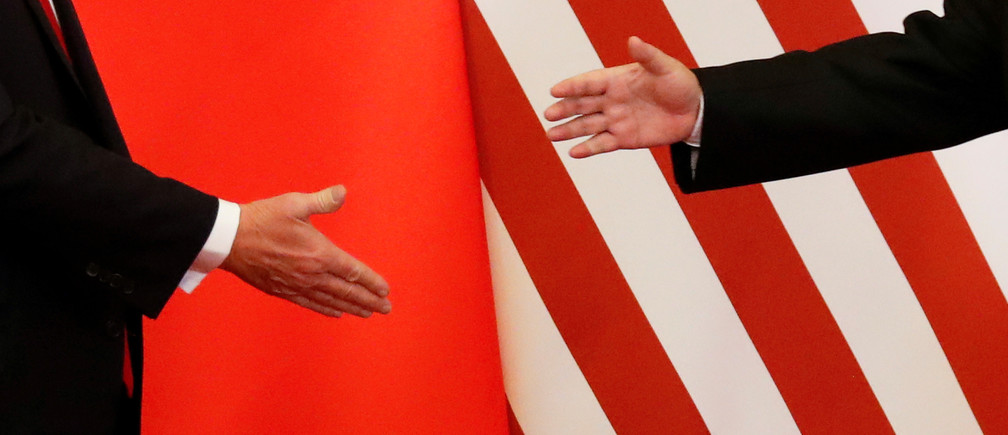 U.S. President Donald Trump and China's President Xi Jinping shakes hands after making joint statements at the Great Hall of the People in Beijing, China, November 9, 2017