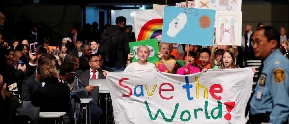 Children are seen during climate march prior to the opening session of the COP23 UN Climate Change Conference 2017, hosted by Fiji but held in Bonn, in World Conference Center Bonn, Germany, November 6, 2017.    REUTERS/Wolfgang Rattay     TPX IMAGES OF THE DAY - RC1D52F82580