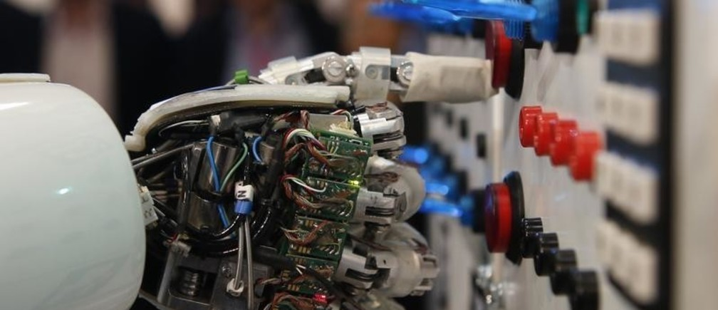 The hand of humanoid robot AILA (artificial intelligence lightweight android) operates a switchboard during a demonstration by the German research centre for artificial intelligence at the CeBit computer fair in Hanover March, 5, 2013.