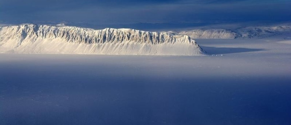 Eureka Sound on Ellesmere Island in the Canadian Arctic is seen in a NASA Operation IceBridge survey picture taken March 25, 2014. IceBridge is a six-year NASA airborne mission which will provide a yearly, multi-instrument look at the behavior of the Greenland and Antarctic ice, according to NASA.  Picture taken March 25, 2014.   REUTERS/NASA/Michael Studinger/Handout  (CANADA - Tags: SCIENCE TECHNOLOGY ENVIRONMENT)  ATTENTION EDITORS - THIS PICTURE WAS PROVIDED BY A THIRD PARTY. REUTERS IS UNABLE TO INDEPENDENTLY VERIFY THE AUTHENTICITY, CONTENT, LOCATION OR DATE OF THIS IMAGE. THIS PICTURE IS DISTRIBUTED EXACTLY AS RECEIVED BY REUTERS, AS A SERVICE TO CLIENTS. FOR EDITORIAL USE ONLY. NOT FOR SALE FOR MARKETING OR ADVERTISING CAMPAIGNS - RTR3KGVN