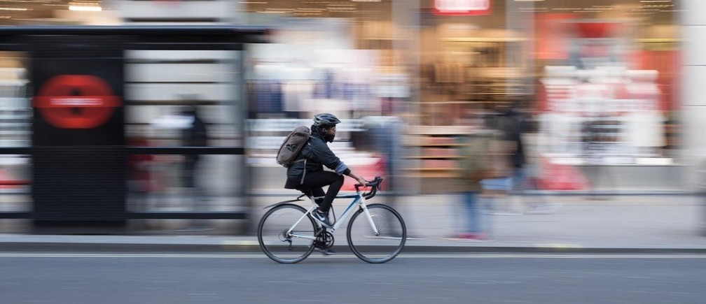 Time lapse photo of person cycling.