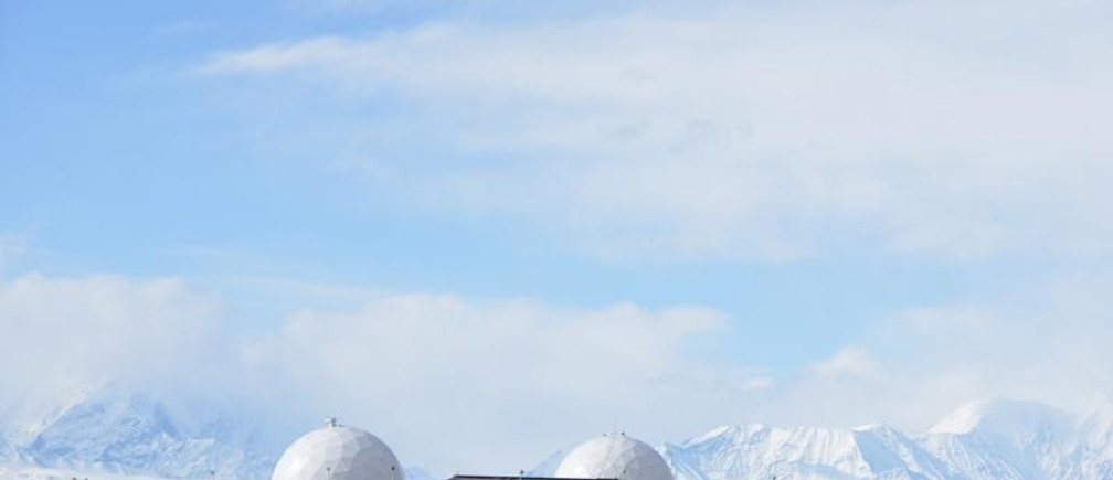 Defense Satellite Communication System with Alaska Range in the background at the Ft. Greely missile defense complex in Fort Greely, Alaska, U.S., April 26, 2018.  REUTERS/Mark Meyer - RC13D2BABD00
