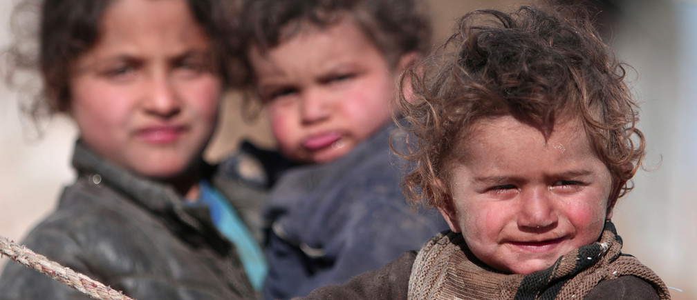 Internally displaced Syrian children who fled Raqqa city stand near their tent in Ras al-Ain province, Syria January 22, 2017. REUTERS/Rodi Said      TPX IMAGES OF THE DAY - RTSWUCG