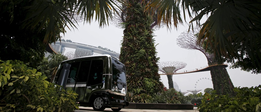 An autonomous self-driving vehicle shuttles member of the media during a demonstration at Gardens by the Bay in Singapore October 12, 2015.