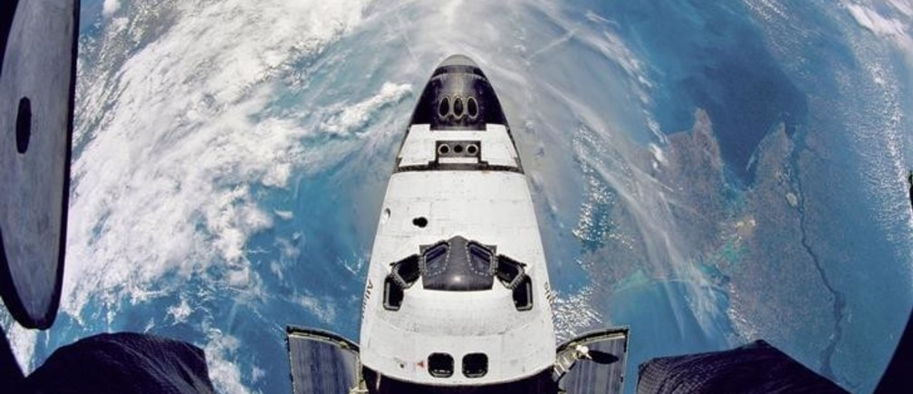 Fish-eye view of the Space Shuttle Atlantis in orbit as seen from the Russian Mir space station during the STS-71 mission on June 29, 1995.   REUTERS/NASA/Kennedy Space Center/Handout  (UNITED STATES - Tags: SCI TECH IMAGES OF THE DAY) FOR EDITORIAL USE ONLY. NOT FOR SALE FOR MARKETING OR ADVERTISING CAMPAIGNS. THIS IMAGE HAS BEEN SUPPLIED BY A THIRD PARTY. IT IS DISTRIBUTED, EXACTLY AS RECEIVED BY REUTERS, AS A SERVICE TO CLIENTS