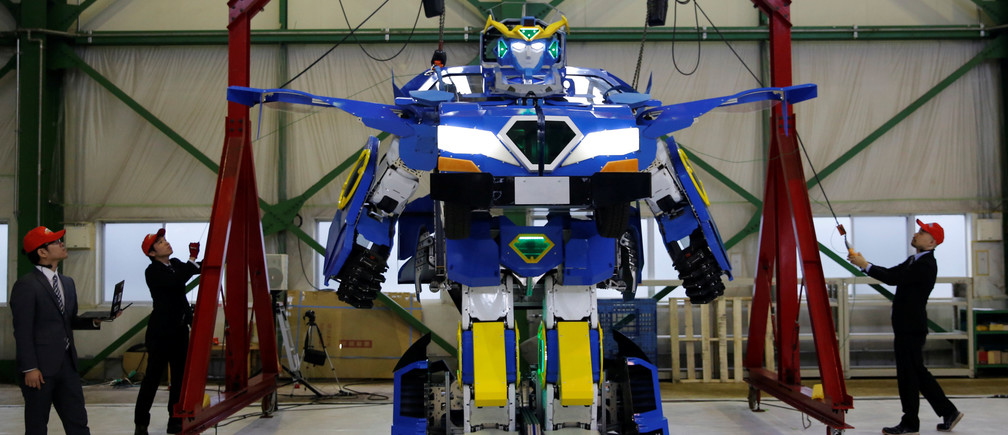 "A new transforming robot called ""J-deite RIDE"" that transforms itself into a passenger vehicle, developed by Brave Robotics Inc, Asratec Corp and Sansei Technologies Inc, is unveiled at a factory near Tokyo, Japan, April 25, 2018. Picture taken April 25, 2018.  REUTERS/Toru Hanai - RC141E7FB450"