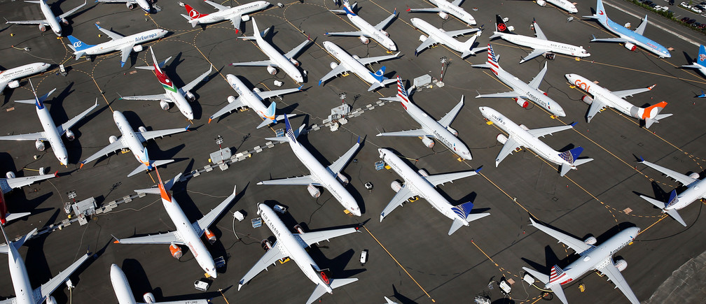 Dozens of grounded Boeing 737 MAX aircraft are seen parked in an aerial photo at Boeing Field in Seattle, Washington, U.S. July 1, 2019. Picture taken July 1, 2019.  REUTERS/Lindsey Wasson - RC18CF54C5E0