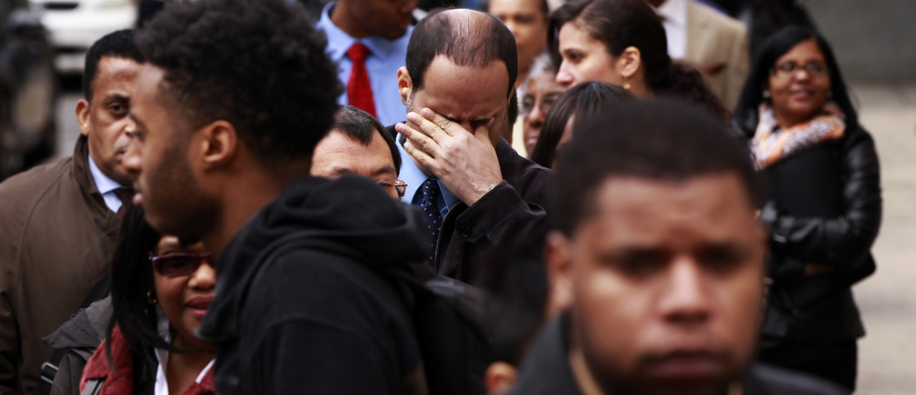 A man rubs his eyes as he waits in a line of jobseekers, to attend the Dr. Martin Luther King Jr. career fair held by the New York State department of Labor in New York April 12, 2012. A report on Friday showed the economy created only 120,000 jobs last month, the fewest since October. The unemployment rate fell to a three-year low of 8.2 percent, but largely as people gave up the search for work.    REUTERS/Lucas Jackson (UNITED STATES - Tags: BUSINESS EMPLOYMENT) - GM1E84D0G4201