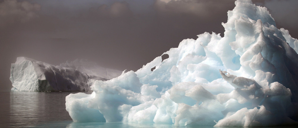 Icebergs float in a fjord near the south Greenland town of Narsaq July 28, 2009.