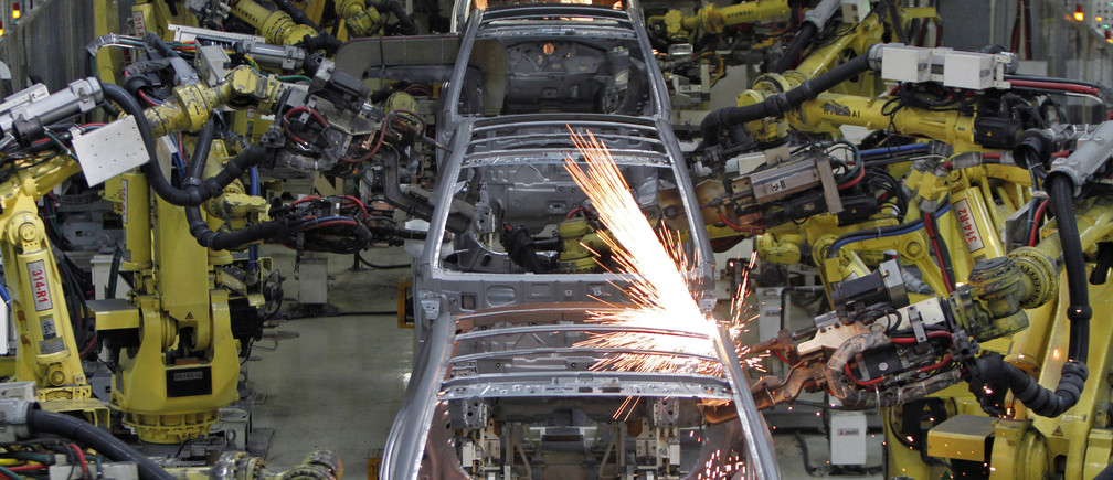 Robot arms assemble cars inside the Hyundai Motor India Ltd. plant at Kancheepuram district in the southern Indian state of Tamil Nadu October 4, 2012. Running around the clock and selling everything it can build, Hyundai Motor's Indian factory is bursting at the seams. But as demand grows and rivals scale up, the car maker has chosen to take its foot off the pedal. Hyundai's strategic decision to focus on quality over quantity, even as its production lines are stretched in India and elsewhere, risks losing hard-won market share and is forcing it to divert output from its plant outside Chennai away from exports to other high-growth markets to meet domestic demand. Picture taken October 4, 2012. To match Analysis HYUNDAI-CAPACITY/         REUTERS/Babu (INDIA - Tags: TRANSPORT BUSINESS) - GM1E8BC06N601