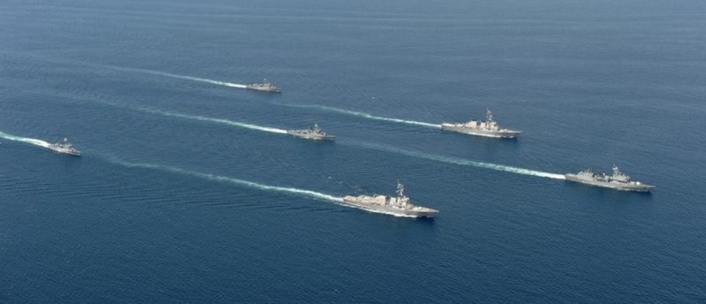 South Korean navy's warships and U.S. navy's Aegis destroyers (2nd R and 3rd R) take part in the joint military exercises between the U.S. and South Korea on the East Sea of South Korea July 27, 2010.    REUTERS/South Korean Navy/Handout (SOUTH KOREA - Tags: MILITARY CONFLICT POLITICS) FOR EDITORIAL USE ONLY. NOT FOR SALE FOR MARKETING OR ADVERTISING CAMPAIGNS - RTR2GRGU