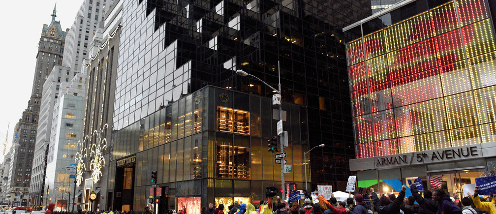 People protest outside Trump Tower during a demonstration organized by the New York Immigration Coalition against President-elect Donald Trump in the Manhattan borough of  New York, U.S., December 18, 2016. REUTERS/Darren Ornitz - RTX2VKXW