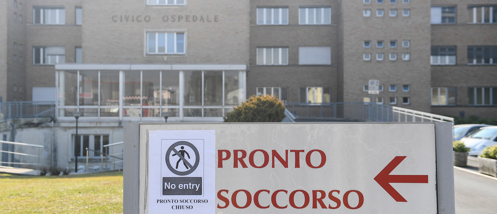 coronavirus italy - A sign advising that the emergency room is closed, is seen at the entrance of the Codogno hospital amid a coronavirus outbreak in northern Italy, February 22, 2020. REUTERS/Flavio Lo Scalzo - RC2O5F9O8YTB