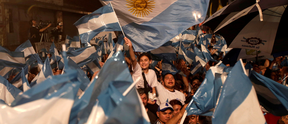 Supporters of presidential candidate Alberto Fernandez, and his running mate and former President Cristina Fernandez de Kirchner, react in Buenos Aires, Argentina October 27, 2019.   REUTERS/Ricardo Moraes - RC1BE2860970