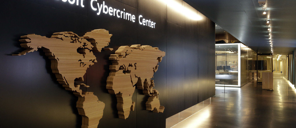 A sign is pictured in the hallway of the Microsoft Cybercrime Center, the new headquarters of the Microsoft Digital Crimes Unit, in Redmond, Washington November 11, 2013. Microsoft, the maker of the most popular computer operating system in the world is launching a new strategy against criminal hackers by bringing together security engineers, digital forensics experts and lawyers trained in fighting software pirates under one roof at its new Cybercrime Center.   Picture taken November 11, 2013. To match Feature MICROSOFT-CYBERCRIME/  REUTERS/Jason Redmond (UNITED STATES - Tags: BUSINESS SCIENCE TECHNOLOGY CRIME LAW) - RTX15D4T