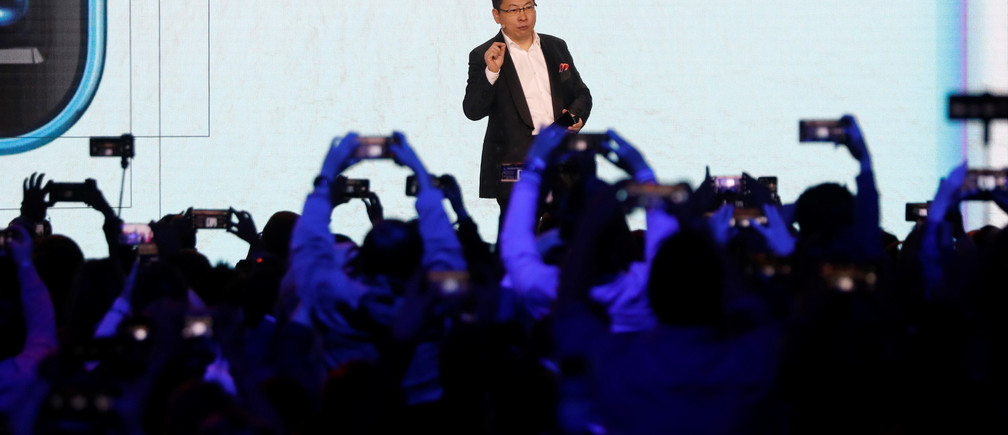 Richard Yu, CEO of the Huawei Consumer Business Group unveils the new Huawei P30 and P30 Pro smartphones during a launch event in Paris, France, March 26, 2019. REUTERS/Charles Platiau - RC115D2B97D0