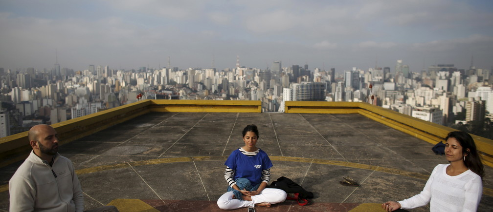 People meditate on the helipad of Copan building to celebrate World Health Day.