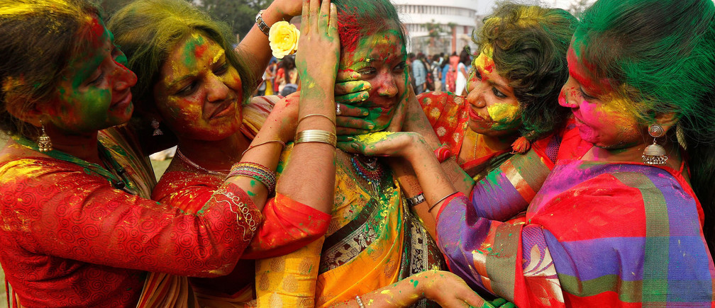 Students of Rabindra Bharati University smear each other with colour powder during Holi, the Festival of Colours, celebrations inside the university campus in Kolkata, India, March 9, 2017