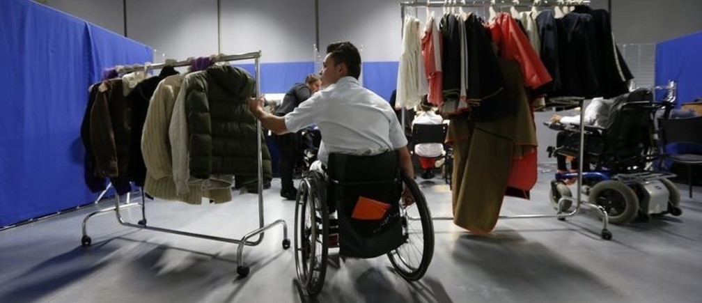 """A model with physical disabilities prepares for French designer Chris Ambraisse Boston's ready-to-wear fashion collection for disabled people in Paris November 29, 2012. Boston, founder of the association """"Fashion and Handicap, it's possible"""", presents his new show named """"A fashion which sublimates differences"""", a collection for people with physical disabilities, at the Cite de la Mode et du Design in Paris. REUTERS/Benoit Tessier (FRANCE - Tags: FASHION SOCIETY) - GM1E8BU0H6101"""