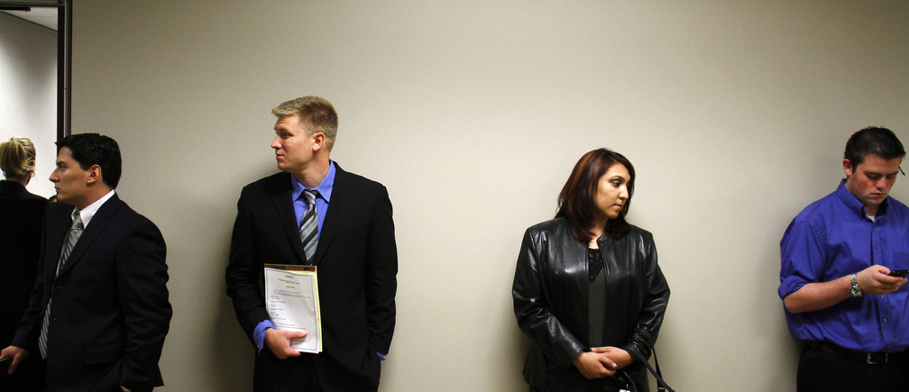 People wait to be interviewed during the Chase Bank Veterans Day job fair in Phoenix, Arizona November 11, 2011. Chase Bank plans on hiring over 300 new hires, including veterans, for their open positions, according to local media. REUTERS/Joshua Lott (UNITED STATES - Tags: BUSINESS EMPLOYMENT SOCIETY) - RTR2TWHI
