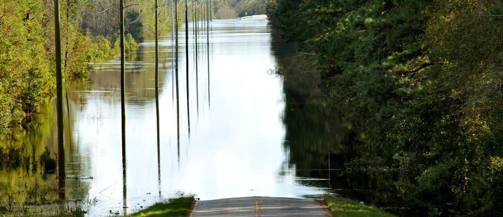 About a mile of flood waters obscure a highway and bridge over the Black River in the aftermath of Hurricane Florence, now downgraded to a tropical depression, near Atkinson, North Carolina, U.S., September 18, 2018. REUTERS/Jonathan Drake - RC179008C910