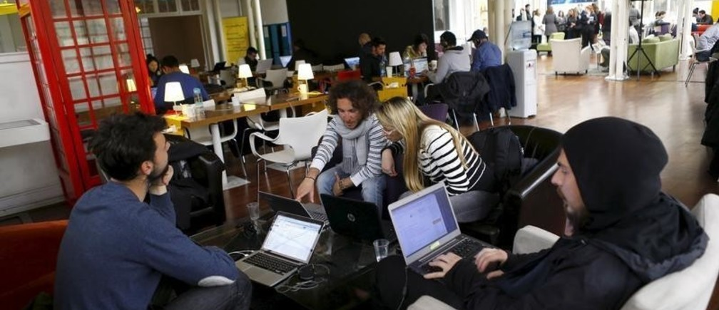 "Participants of the ""Start Up Chile"" program work at their headquarters in Santiago, August 10, 2015. Drawn in by equity-free financing and promises of hands-on mentorship, dozens of female entrepreneurs will head to Chile in the coming weeks to participate in what the government says is the world's first state-run start-up program aimed exclusively at women. It's not the first attempt by Chile to catalyze its start-up scene. Since 2010, the government has awarded over $40 million in seed capital to thousands of up-and-coming innovators, according to its own statistics. Picture taken August 10, 2015. REUTERS/Ivan Alvarado - GF10000174915"
