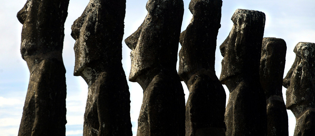 "A view of ""Moai"" statues in Ahu Akivi, on Easter Island, 4,000 km (2486miles) west of Santiago, in this photo taken October 31, 2003. EasterIsland's mysterious ""Moai"", giant head statues carved out of volcanicrock, are in danger of being destroyed by years of tropical rains andwind as well as careless humans and farms animals. Experts have calledon the international community to commit funds to preserve themonoliths, whose mystery draws tourists to the world's most remoteinhabited island. NO RIGHTS CLEARANCES OR PERMISSIONS ARE REQUIRED FOR THIS IMAGE REUTERS/Carlos Barria/FEATURE/SCIENCE-CHILE-MOAI CB - RP4DRIFSJVAD"